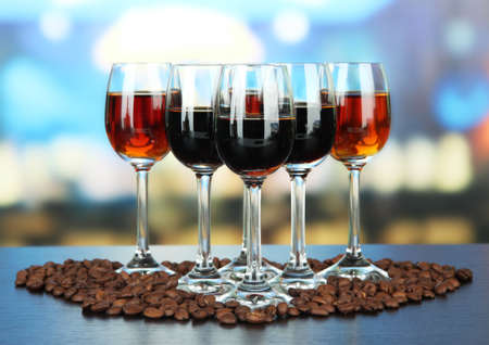 amaretto: Glasses of liquors, on bright background