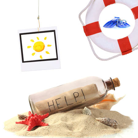 Glass bottle with note inside, lifebuoy and photo of sun isolated on white photo