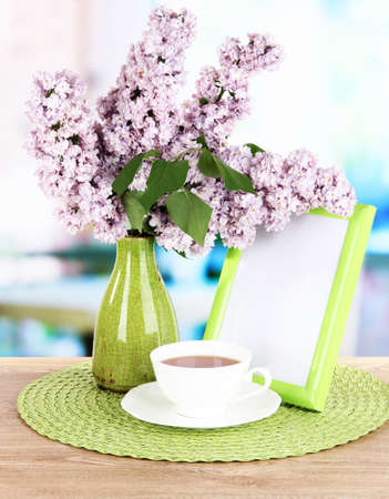Beautiful lilac flowers on table in room Stock Photo - 21384648
