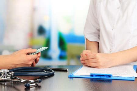 Gynecologist appoints hormone pills patient Stock Photo