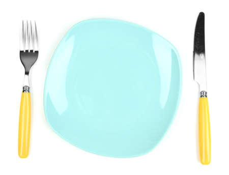 Knife, color plate and fork, isolated on white photo