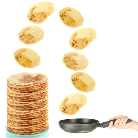 Frying pan with flying pancakes photo