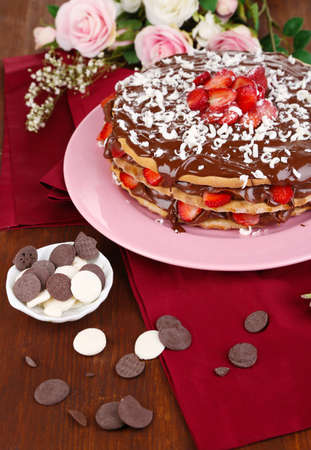 Chocolate cake with strawberry on wooden table close-up photo