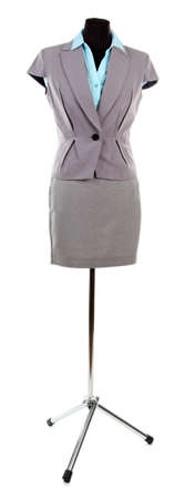 Blue shirt, gray jacket and gray skirt on mannequin,  isolated on white photo