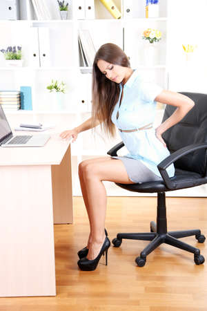 Young business woman in office photo