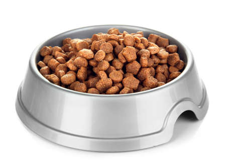 pet food: Dry dog treats in bowl isolated on white