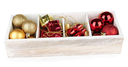 Wooden box filled with christmas decorations, isolated on white photo