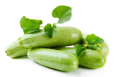 cucurbit: Raw zucchini with leaves, isolated on white