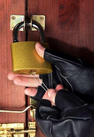 pawl: Robber breaks castle in door close-up