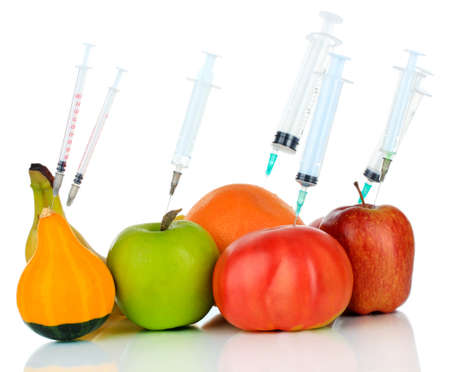 Injection into fruit and vegetables isolated on white Stock Photo