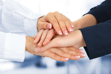 United hands, on office background Stock Photo - 21663301