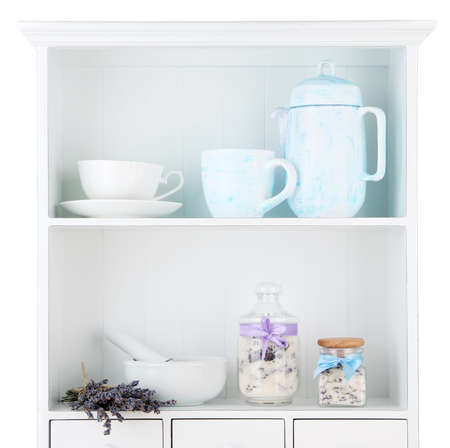 Still life with jar of lavender sugar, mortar and fresh lavender flowers on shelves photo