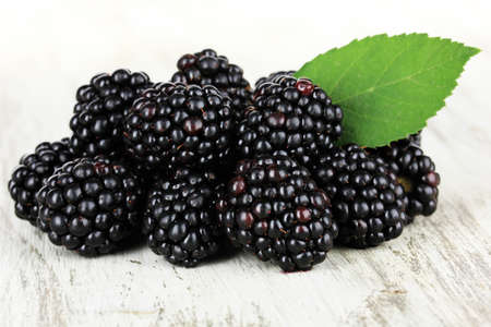 Sweet blackberries on table close-up photo