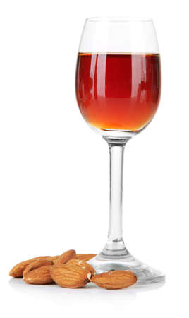 amaretto: Glass of amaretto liquor and roasted almonds, isolated on white Stock Photo