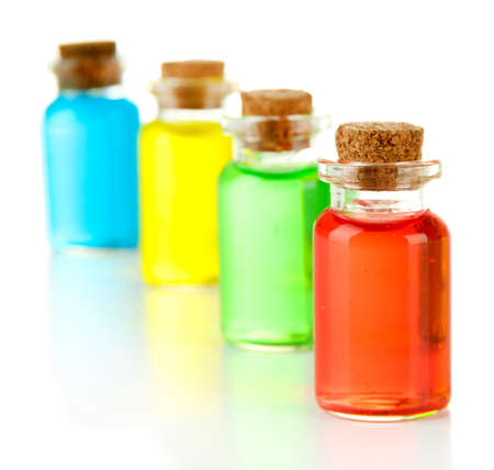 liquids: Bottles with colored liquids isolated on white Stock Photo