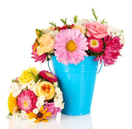 Beautiful bouquet of bright flowers in color vase, isolated on white photo