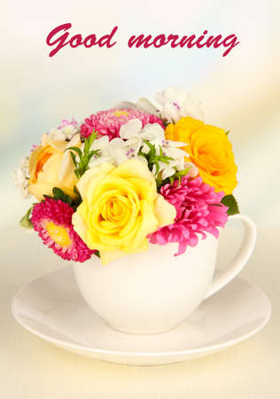 good: Beautiful bouquet of bright flowers in color vase, on wooden table, on bright background