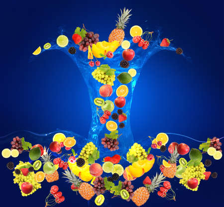 Flight of fruits and berries in water on blue background photo