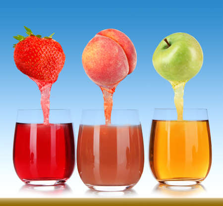 pours: Fresh juice pours from fruits and strawberry into a glasses, on blue background