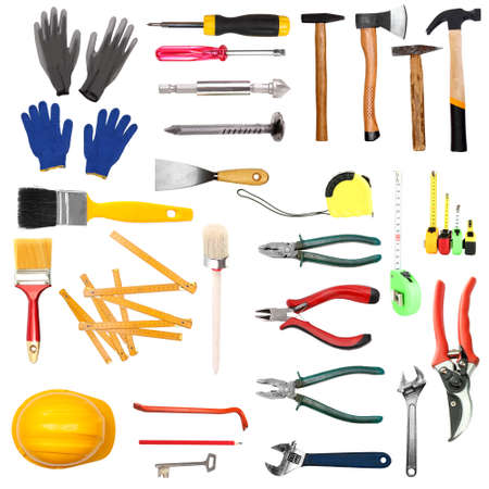 Many different tools  for construction and home isolated on white photo