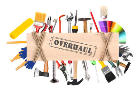 overhaul: Many different tools  for construction and home with inscription Overhaul isolated on white
