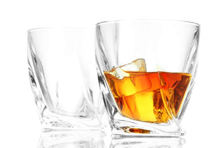 Glasses of whiskey, isolated on white   photo