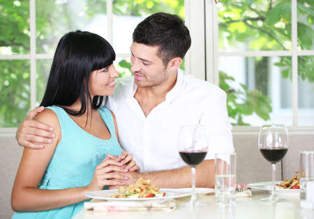 Beautiful young couple at restaurant photo