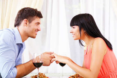 dinner couple: Man proposing engagement ring his woman over restaurant table