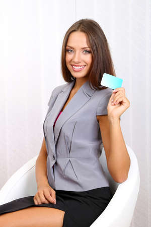 careerists: Young beautiful business woman in office Stock Photo