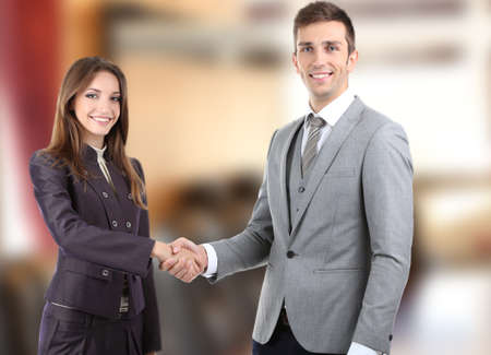 Boardroom meeting: Business colleagues shaking hands at office Stock Photo