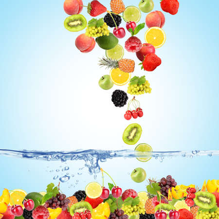 mixed fruit: Flight fruits and berries in water on blue background