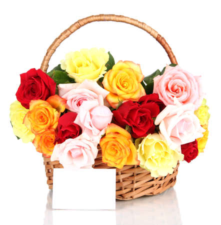 Beautiful bouquet of roses in wicker basket isolated on white photo