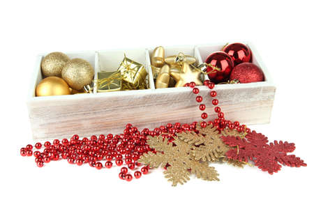 stock photo wooden box filled with christmas decorations isolated on white - Wooden Box Christmas Decorations