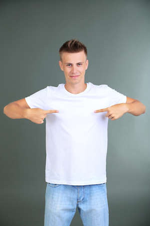 T-shirt on young man, on grey background photo