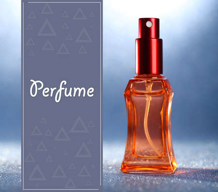 Women perfume in beautiful bottle on blue background photo