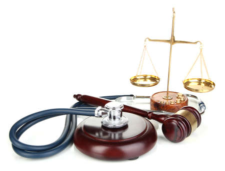 Medicine law concept. Gavel, scales and stethoscope isolated on white