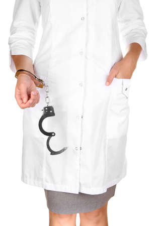 Doctor in handcuffs isolated on white photo