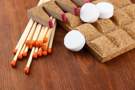 exalt: Long matches and dry fuel, on wooden background