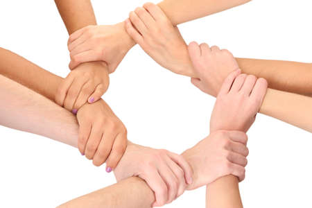 strong partnership: Ring of hands, isolated on white.  Conceptual photo of teamwork