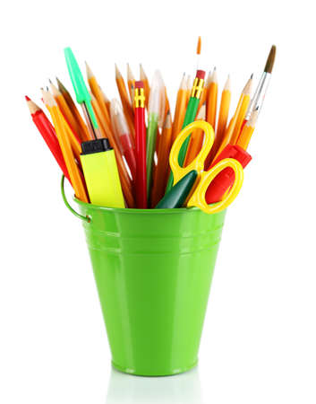 Colorful pencils and other art supplies in pail isolated on white photo