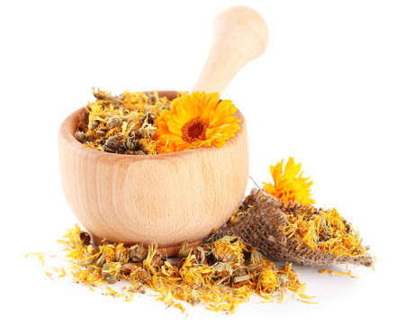 Fresh and dried calendula flowers in wooden mortar  isolated on white photo