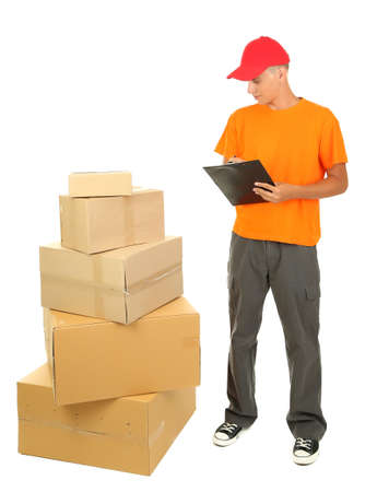 Young delivery man with parcels and clipboard, isolated on white photo