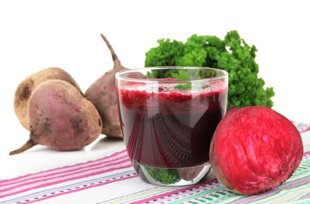 beet juice: Fresh juice of beets on table on white background