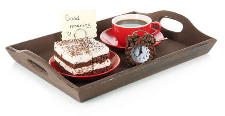 Cup of tea with cakes on wooden tray isolated on white photo
