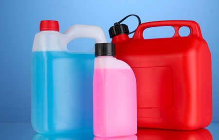 antifreeze: Liquids for car in canisters on blue background