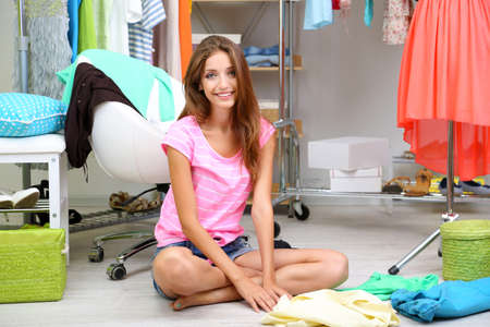 blouses: Beautiful girl chooses clothes in walk-in closet