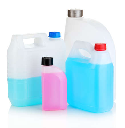 antifreeze: Different liquids for car in canisters isolated on white Stock Photo