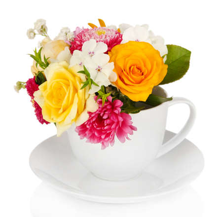 Beautiful bouquet of bright flowers in color mug, isolated on white photo