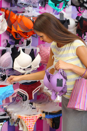 ladies underwear: Beautiful young woman in shop with underwear Stock Photo