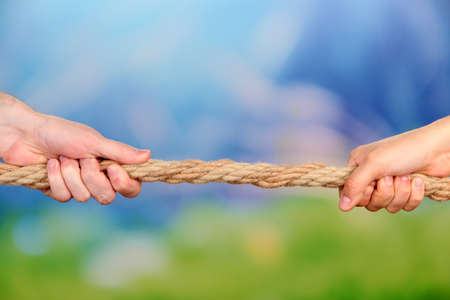 Tug of war, on bright background photo
